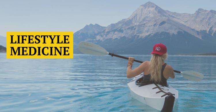 Lifestyle medicine image of girl kayaking on a lake